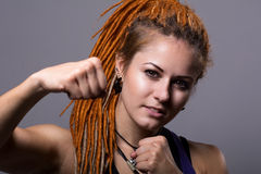 Close-up portrait young woman with dreadlocks in a fighting stan Royalty Free Stock Images