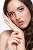 Close-up portrait of young woman with face art  make up and mani. Close-up portrait of beautiful young woman with face art  make up and manicure Stock Photos