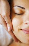 Close up portrait of a young woman getting spa treatment Royalty Free Stock Images