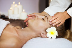Close up portrait of a young woman getting spa treatment Stock Images