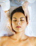 Close up portrait of a young woman getting spa treatment Stock Photo