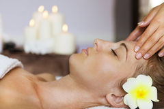 Close up portrait of a young woman getting spa treatment Stock Photography