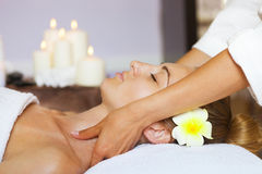 Close up portrait of a young woman getting spa treatment Stock Photos