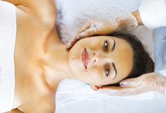 Close up portrait of a young woman getting spa treatment Royalty Free Stock Image