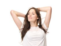 Close up portrait of a young woman with hand in hair Royalty Free Stock Photos