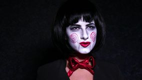 Pretty woman in horror style make up sings a song on dark background Royalty Free Stock Photo