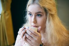 Close-up portrait of young woman with long blond hair and blue e stock photo