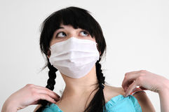 Close-up portrait of young woman in protective medical mask Stock Images