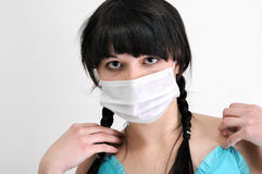 Close-up portrait of young woman in protective medical mask Royalty Free Stock Images