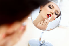 Close up Portrait of Young Woman With Red Lips. Beautiful Woman Doing Daily Makeup. Royalty Free Stock Photo