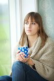 Young Woman Relaxing with Cup of Tea Royalty Free Stock Photo