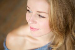 Close up portrait of a young woman smiling. Side view Stock Photo
