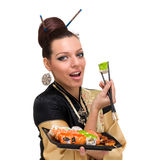 Close up portrait of young woman with sushi Royalty Free Stock Images