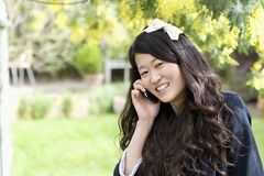 Close up portrait of young woman talking on mobile phone Stock Photos