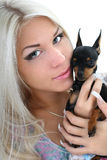 Close-up portrait of young woman with toy-terrier Royalty Free Stock Photography