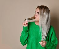 Close up portrait of young woman troubled about her hair stock photography