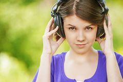 Close-up portrait of young woman wearing headphones Stock Image