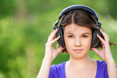 Close-up portrait of young woman wearing headphones Royalty Free Stock Photography
