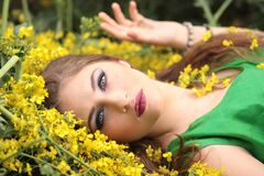 Close-up Portrait of Young Woman With Yellow Flowers stock photo