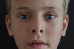 Close up portrait of young wondering blonde boy in space with pl Royalty Free Stock Photos