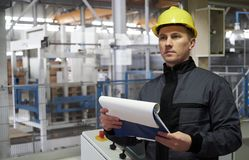 Close-up Portrait of a young worker in a factory royalty free stock images