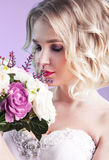 Close up portrait of yuong beautiful bride with flowers over pin. K background Stock Photos