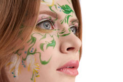 Close-up portrate of young girl witn faceart. Close-up portrate of young girl with faceart, looking away Stock Photo