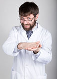 Close-up portret of a Doctor, stethoscope around his neck. He gleefully rubbing his hands. different emotions Stock Image