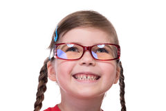 Close up portret of little girl wearing glasses. And looking up Royalty Free Stock Photos