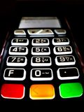 Close up of POS Terminal with backlit keypad royalty free stock image