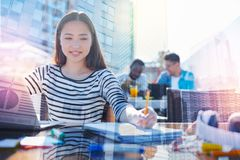 Close up of positive girl preparing for exams royalty free stock photos