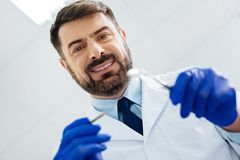 Close up of positive stomatologist with instruments Royalty Free Stock Photo