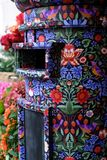 Close up of post box covered in Liberty print, located in the flower shop outside Liberty of London store. Close up of post box covered in Liberty print royalty free stock photos