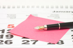 Close up of Post-It Note on Calendar Royalty Free Stock Photo