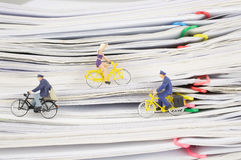 Close up postmen and woman cycling on pile overload paperwork Stock Photo