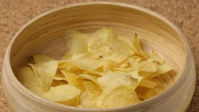 Close up of potato chips pouting into bowl stock video