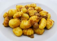 Close-up of potato gnocchi with bolognese sauce ragu on a white plate royalty free stock photos