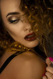 Close up potrait of beautiful lady with make up and curly hair Royalty Free Stock Photo