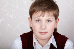 Close-up potrait of boy in white shirt Royalty Free Stock Photo