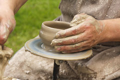 Close up of potter`s hands Royalty Free Stock Image
