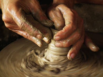 Close-up of potter turning a pot on a potter Royalty Free Stock Photography