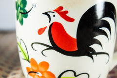 Close-up pottery cup painting to gamecock Royalty Free Stock Photo