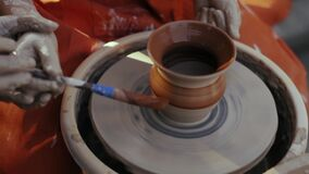 Close-up, Pottery Mastery Lesson, Teacher Teaches Apprentice To Work with Clay on The Pottery Circle