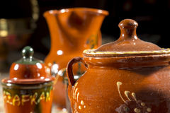 Close-up of pottery sugar bowl in front of other jars Stock Photo