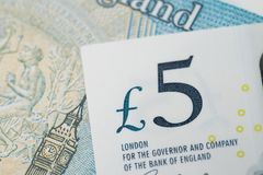Close-up of 5 pound sterling England currency banknotes, Brexit, UK economics, saving, financial or investment with. Europe, business profit and loss concept royalty free stock images