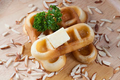Close-up pour honey from top of waffles and nut. Which has parsley and cheese on top of waffles on wood plate for breakfast Royalty Free Stock Photo