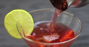 Close up of pouring classic cocktail, Cosmopolitan stock video footage