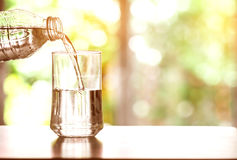 Close up the pouring purified fresh drink water from the bottle Stock Photos