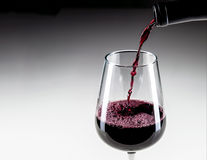 Close-up Pouring Red Wine Into Glass royalty free stock photography
