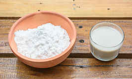 Close up powder in bowl and milk Royalty Free Stock Image